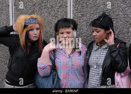 THREE TEENAGE GIRL CHATTING AND SOCIALIZING - Stock Photo