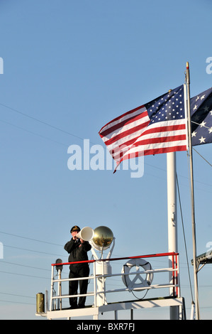 Captain using megaphone to give docking instructions to bridge, Natchez Riverboat, Mississippi River, New Orleans, - Stock Photo