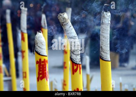 Incense sticks burning at the Po Lin Monastery on Lantau Island in Hong Kong, China - Stock Photo