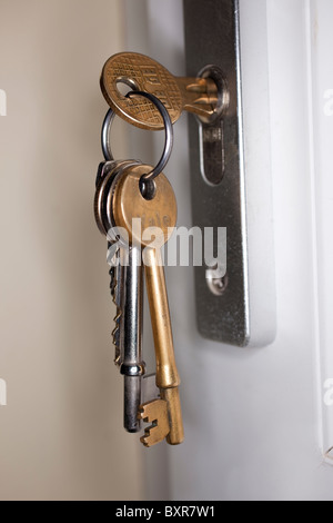 set of keys in a door lock - Stock Photo