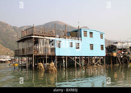Stilt house in Tai O fishing village with houses on stilts on Lantau Island in Hong Kong, China - Stock Photo
