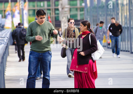 Indian ethnic minority in Australia: migrants or overseas student couple. The woman, in traditional costume, is - Stock Photo