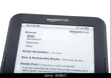 The 2010/11 Amazon Kindle ebook reader linked to the amazon.co.uk store via Wi-Fi, UK - Stock Photo
