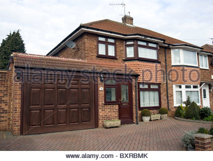 Front view of a typical three bedroom suburban semi detached house in Essex - Stock Photo