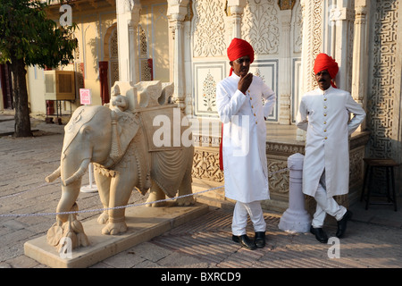 Two guards of Royal Palace in Rajasthan , India white red turban and royal uniform - Stock Photo