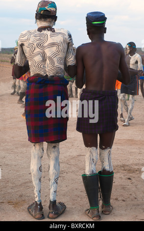Two Nyangatom (Bumi) men with painted back, Omo river Valley, Ethiopia Africa - Stock Photo