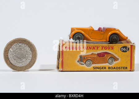 DINKY DUBLO 62 Singer Roadster and box with two pound coin to show scale - Stock Photo