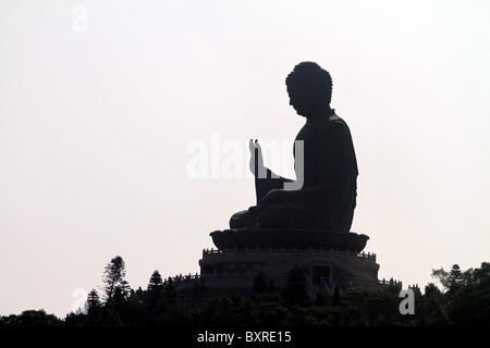 Silhouette of the Tian Tan Buddha statue on Lantau Island in Hong Kong, China - Stock Photo