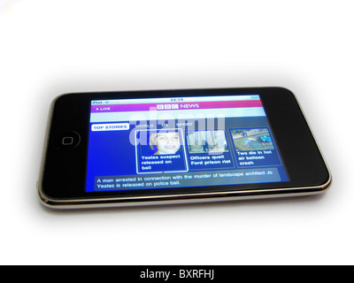 cutout of ipod touch showing bbc news home page Joanna Yeates murder enquiry on white background - Stock Photo