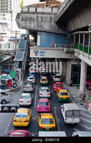 Many traffic jams on Sukhumvit Road in Bangkok right under the skytrain tracks. - Stock Photo