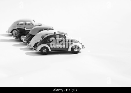 Collectible die cast toy models of Four Volkswagen Beetles cars Black and White - Stock Photo