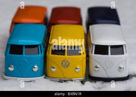 Children's collectible toy models of  Volkswagen split screen panel vans on Snow - Stock Photo