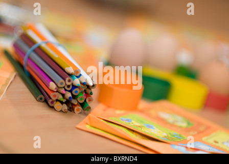 Pencils and other art stuff on child's desk - Stock Photo