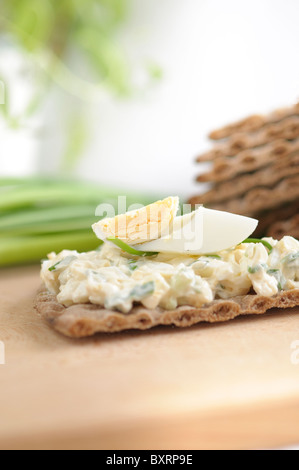 Egg Pasta with chives on a Dark Thin Diet Bread - Stock Photo