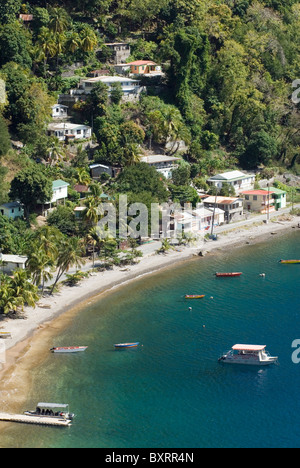 Caribbean, Windward Islands, Dominica, Soufriere Bay, View of bay with building - Stock Photo