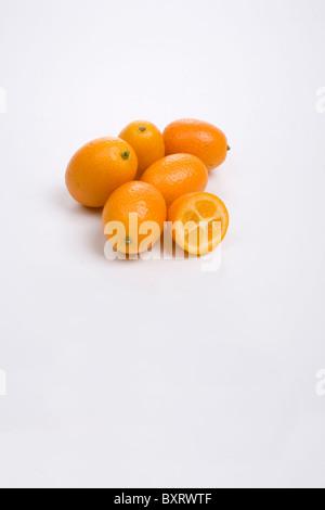 Kumquats on white background - Stock Photo