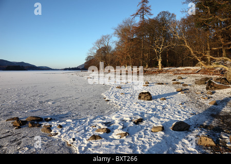 A Snowy and Frozen Derwent Water and the View North Borrowdale Lake District Cumbria - Stock Photo