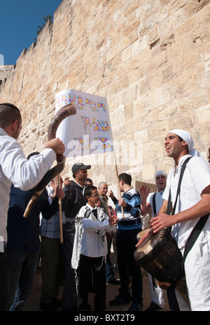 Drummers accompanying a youngster to his bar Mitzvah ceremony by city walls. Jerusalem Old City - Stock Photo