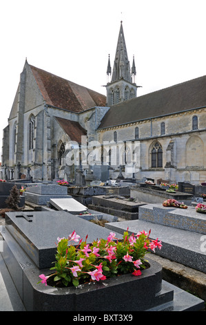 Part of the cemetery or graveyard of Eglise or Church of Saint Denis in Crepy en Valois France - Stock Photo