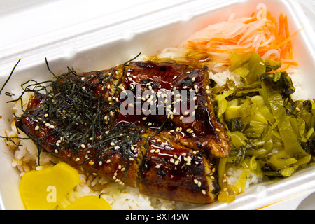 Eel on rice with vegetable in a white take out lunch box - Stock Photo