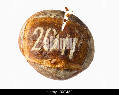 round loaf of bread dusted with the year 2011 - Stock Photo