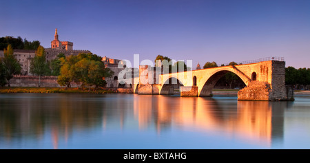Early morning at Pont St. Benezet over River Rhone with Palais des Papes, Avignon France - Stock Photo