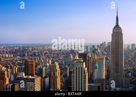 Late afternoon view of the Empire State building and the skyline of Manhattan, New York City USA - Stock Photo
