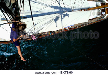 Woman On Mast Taking Pictures Of Tourist Down Below, Aerial View - Stock Photo