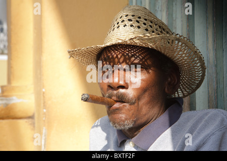 TRINIDAD: CUBAN MAN SMOKING CIGAR - Stock Photo
