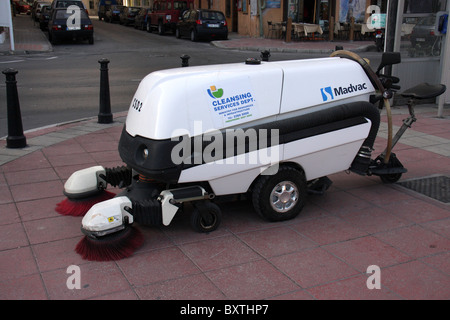madvac automatic mechanical road cleaning machine cleaning the streets - Stock Photo