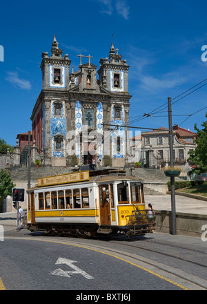 Portugal, Porto, Praca Da Batalha, A Sightseeing Tram Outside Santo Ildefonso Church - Stock Photo