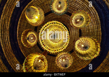Upward view of light fixtures in Serena Lodge, Lake Manyara, Tanzania - Stock Photo