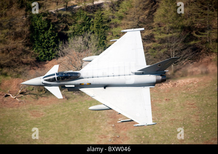 A Eurofighter Typhoon F2 aircraft of the Royal Air Force low flying over North Wales. - Stock Photo