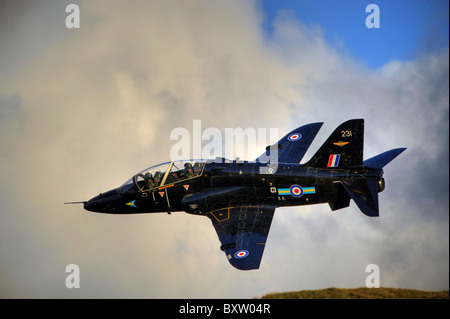 A Hawk T1 trainer aircraft of the Royal Air Force low flying over North Wales. - Stock Photo
