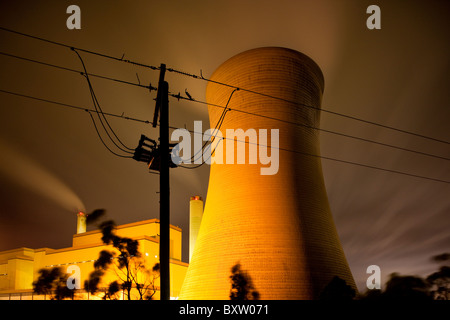 Australia Victoria Yallourn Time exposure power lines in front of steam venting from cooling towers at coal-fired - Stock Photo
