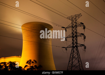 Australia, Victoria, Yallourn, Time exposure of Tru Energy coal-fired power station and high tension lines at night - Stock Photo