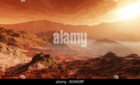 The Martian sun sets over the high walls of Mojave Crater. - Stock Photo