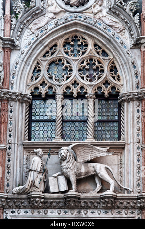 Statue of winged lion of St. Mark with Doge Foscari, Palazzo Ducale or Doge's Palace, Venice, Italy - Stock Photo