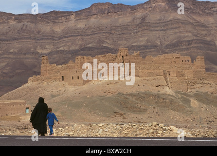 Mother And Child Walking Down Road - Stock Photo