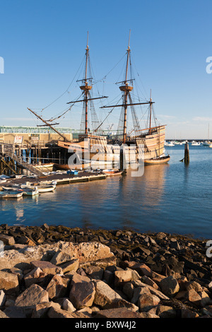 Mayflower II and other boats moored in Plymouth Harbor at dawn in Plymouth Massachusetts - Stock Photo