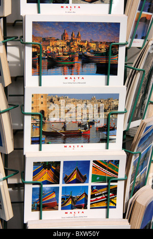 post cards of colourful fishing boats and buildings of malta from a suvenier shop,valetta,malta - Stock Photo