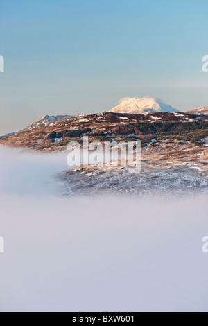 View of Ben Lomond above a mist covered Loch Lomond. From the summit of the Conic, near Balmaha, Drymen, Scotland, - Stock Photo