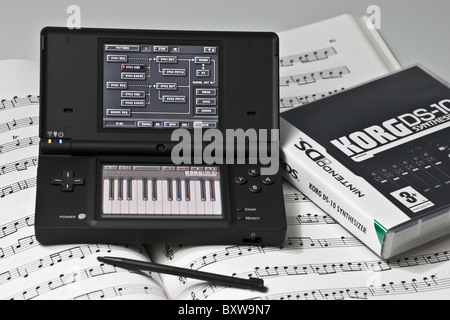 Nintendo DS2 hand held electronic game with Korg DS-10 music synthesizer and sequencer program - Stock Photo
