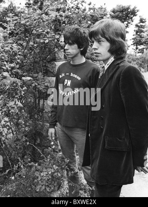 Keith Richards and Mick Jagger exclusive image from 1967 by David Cole in the gardens at Redlands, Richards' Sussex - Stock Photo