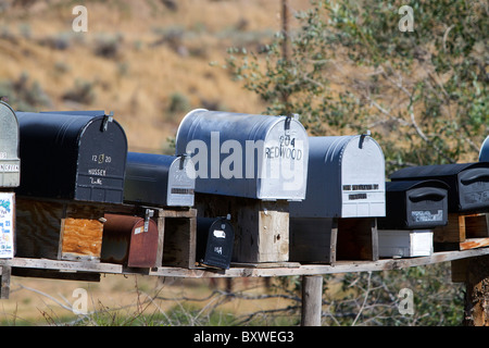 Mailboxes lined up for the delivery of mail in a rural area near Challis, Idaho, USA. - Stock Photo