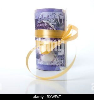 Rolled bunch of banknotes, Pound sterling - Stock Photo