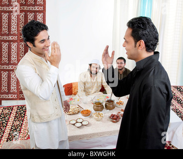 Muslims greeting each other stock photo 69901634 alamy muslim men greeting each other stock photo m4hsunfo