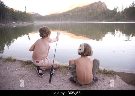 Two young boys fishing.  Fenton Lake, Jemez Springs, New Mexico, USA - Stock Photo