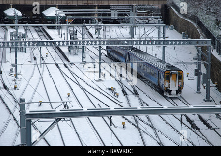 A train pulls in to Waverley Station in Edinburgh after a fall of snow. - Stock Photo