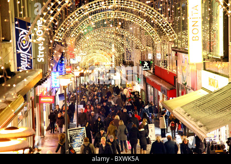 Shopping street, pedestrian area, illumination, people going shopping, Essen, Germany. - Stock Photo